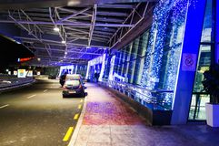 Christmas illuminations in the national airport Minsk. New Year. Departure and  Kiss & Fly area. Bus Stop Stock Photos