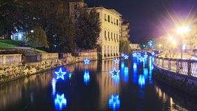 Christmas illuminations. Over the river Sile in Treviso Stock Image