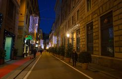 Christmas illuminations on the streets of center of Genoa by night, Italy. royalty free stock image