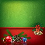 Christmas illustrated border. Red and green Christmas border illustrated with gold bells, colorful ornaments and pine cone with copy space Royalty Free Stock Photos