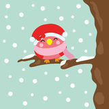 Christmas illustration with cute bird smiles on snowfall background suitable for Xmas kid greeting season, wallpaper, and postcard Royalty Free Stock Images