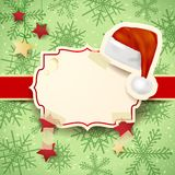 Christmas illustration with label and Christmas hat Royalty Free Stock Images