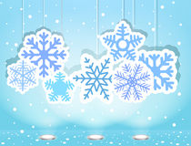Christmas illustration with snoflakes. On blue Royalty Free Stock Photos