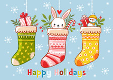 Christmas illustration with socks and gifts in them. royalty free stock images