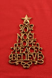 Christmas Image. A golden Christmas tree made up of the words Joy, Noel, Hope, Peace, and Believe Stock Photo