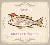 Christmas image of Fishing with fish in Santa hat. Vintage Christmas image of Fishing with fish in Santa hat .Vector drawing card for text Stock Photo