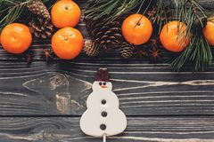 Christmas image flat lay. christmas candy snowman and fir branch Stock Photo
