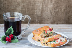 Christmas image of slices of fruit cake on plate with cup of coffee Royalty Free Stock Images
