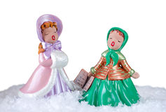 Christmas image of two beautiful vintage carol singers Stock Images
