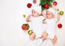 Christmas infant twins Stock Images