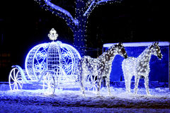 CHRISTMAS, INSTALLATION. Light installation Cinderella carriage in winter park Royalty Free Stock Photos