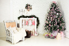 Christmas interior. Nice Christmas interior with a fir tree, armchair and gifts Royalty Free Stock Image