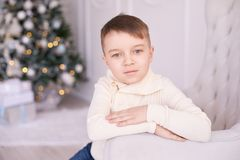 Christmas interior. Beautiful portrait. Little boy. Horizontally. Christmas interior. Beautiful portrait. Cute little boy. Horizontally. Light background Royalty Free Stock Image