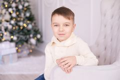 Christmas interior. Beautiful portrait. Little boy. Horizontally. Christmas interior. Beautiful portrait. Little cute boy. Horizontally. Light background Royalty Free Stock Image