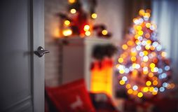 Christmas interior with Christmas tree fireplace and door royalty free stock photo