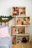 Christmas interior country style. Design room with Christmas fir and the bed. Interior country style Royalty Free Stock Photos
