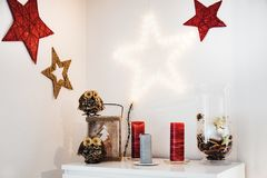 Christmas interior decoration on the wall and sideboard with owl. S and red stars Stock Image