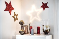Christmas interior decoration on the wall and sideboard with owl. S and red stars Royalty Free Stock Photos