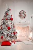 Christmas interior and decorations. Snowy tree decorated red gif Royalty Free Stock Photos