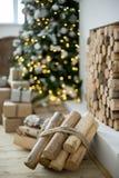 Christmas interior eco style bokeh. Design room with Christmas tree, sofa and the fireplace. Interior eco style bokeh royalty free stock photography