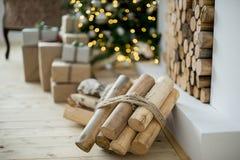 Christmas interior eco style bokeh. Design room with Christmas tree, sofa and the fireplace. Interior eco style bokeh stock photos
