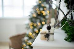 Christmas interior eco style bokeh. Design room with Christmas tree, sofa and the fireplace. Interior eco style bokeh stock images
