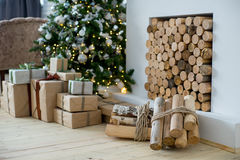 Christmas interior eco style. Design room with Christmas tree, sofa and the fireplace. Interior eco style royalty free stock photos