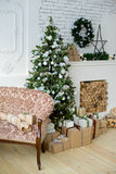 Christmas interior eco style. Design room with Christmas tree, sofa and the fireplace. Interior eco style stock image