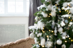Christmas interior eco style. Design room with Christmas tree, sofa and the fireplace. Interior eco style stock images
