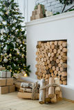 Christmas interior eco style. Design room with Christmas tree, sofa and the fireplace. Interior eco style royalty free stock images