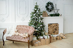 Christmas interior eco style. Design room with Christmas tree, sofa and the fireplace. Interior eco style stock photography