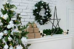 Christmas interior eco style. Design room with Christmas tree, sofa and the fireplace. Interior eco style stock photo