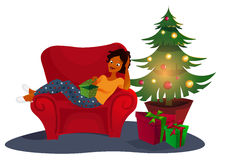 Christmas interior with an elegant red sofa. Comfort home. .  tree  presents Royalty Free Stock Photography
