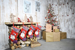 Christmas interior with fireplace, Christmas tree and gifts Stock Images