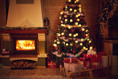 Christmas interior with fireplace and fir tree. Beautiful Christmas interior with fireplace and fir tree Stock Photos
