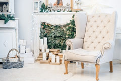 Christmas interior. With hearth, armchair and candles Stock Images