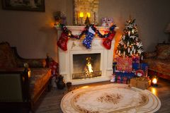 Christmas interior panorama - living room and decorated fireplace. royalty free stock image