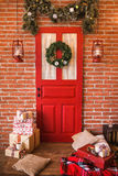 Christmas interior in red and brown colors Stock Photos