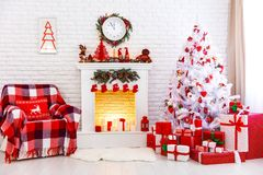 Christmas interior in red and white colors with tree and firepla. Christmas interior in red and white colors with Christmas tree and fireplace Royalty Free Stock Image