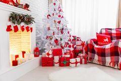 Christmas interior in red and white colors with tree and firepla. Christmas interior in red and white colors with Christmas tree and fireplace royalty free stock photography
