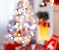 Christmas interior in red and white colors with tree and firepla Royalty Free Stock Image