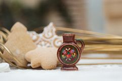 Christmas interior with a small ceramic jug and gingerbreadgs royalty free stock images