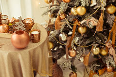 Christmas interior. A stylish interior with elegant Christmas tree decorated Royalty Free Stock Photography