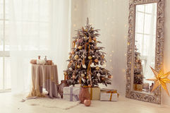 Christmas interior. A stylish interior with elegant Christmas tree decorated Royalty Free Stock Photos