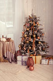 Christmas interior. A stylish interior with elegant Christmas tree decorated Royalty Free Stock Image