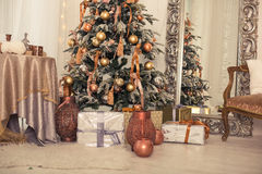 Christmas interior. A stylish interior with elegant Christmas tree decorated Stock Images