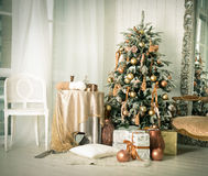 Christmas interior. A stylish interior with elegant Christmas tree decorated Stock Photography