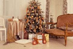 Christmas interior. A stylish interior with elegant Christmas tree decorated Stock Photo