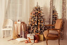 Christmas interior. A stylish interior with elegant Christmas tree decorated Stock Photos