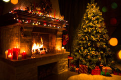 Christmas interior with tree, presents and fireplace stock images
